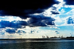 clouds and cranes (moaan) Tags: leica light sea sky beach clouds 50mm cloudy crane f10 giraffe mp noctilux 2009 ashiya rayoflight rvp fujivelvia  fujivelvia100 rvp100 leicamp explored fujirvp  leicanoctilux50mmf10 ashiyahama january2009 seagiraffe cloudywithoccasionalfair thebillows gettyimagesjapanq1 gettyimagesjapanq2