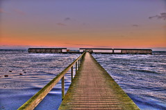 Same jetty - Different conditions (OrangUtanSam) Tags: bridge sunset sea sky water clouds copenhagen denmark dragr waves skies sweden hometown boardwalk earlysunset dragoer seabath oeresound orangutansam johansamsom bathingsite