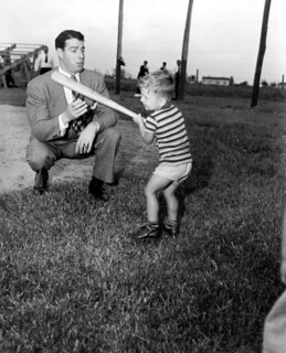 Joe DiMaggio showing three year old Larry Vale...