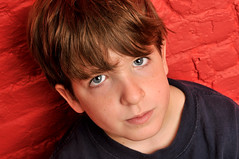 Tanner's mini photo shoot on red (age 7) 18 (Violentz) Tags: boy red male kid modeling indoors nephew tanner redwall