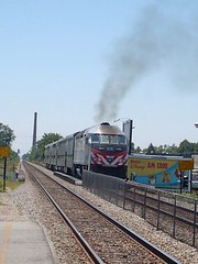 Southbound Metra commuter local departing the Forest Glen commuter flagstop depot. Chicago Illinois. June 2007.