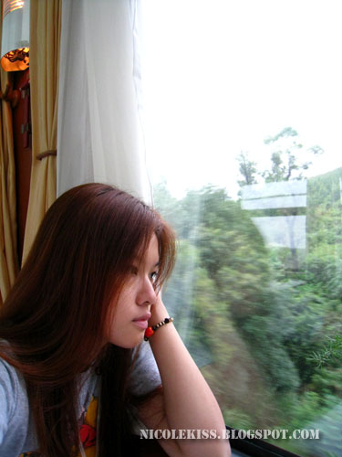 gazing out of window on train
