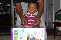 Opening presents with paw paw (deidra_morrison) Tags: christmas family friends playing toys san december texas drum grandpa gift presents napoleon 25th antonio 2008 pawpaw