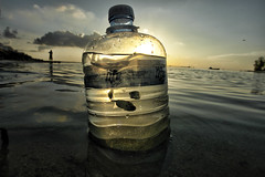Wake Up (eyebe / aibe) Tags: blue sunset sea fish yellow landscape bottle sand drugs wakeup maldives villigili eyebe lifebottle preveting