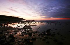 Westward Ho Sunset (Mizan Ahmed) Tags: sunset sea sky beach clouds landscape coast rocks long exposure sigma ho westward pebbels aplusphoto