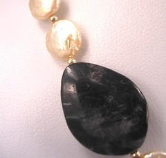 Dark hypersthene (in a necklace with coin pearls)