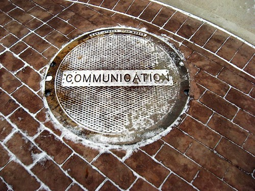 manhole that says communication
