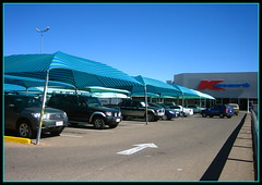 Kmart Cares (suavehouse113) Tags: cars parkinglot stripes australia shoppingcentre bluesky tent sunshade parked arrow canopy carpark redcenter kmart northernterritory alicesprings redcentre shadesail