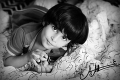 Innocent Eyes ,, (A.A.A) Tags: family boy white playing black eye love smile look by photography eos photo kid eyes child mark iii innocent bin nephew mohammed photograph 1ds fahad eyez  althani  eos1dsmarkiii alshai5 amnaaalthani