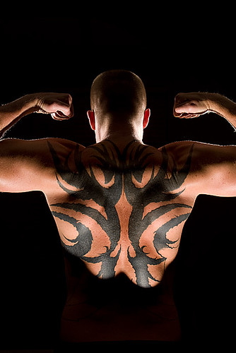 tribal strength tattoo