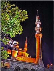 Eminonu mosque at night (maistora) Tags: travel light sea color colour tree leaves night turkey asia europe crossing projector minaret branches trkiye culture istanbul mosque spotlight hdr bosphorus anatolia crossculture eminonu tonemapping 5photosaday 3exposure maistora