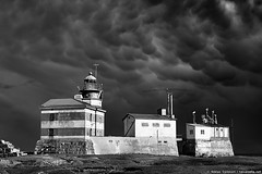 Mammatocumulus above Mrket lighthouse (taivasalla) Tags: sea summer sky blackandwhite bw cliff cloud lighthouse storm clouds suomi finland geotagged island rocks kallio sweden balticsea cliffs thunderstorm thunder islet meri itmeri archipelago kes luoto aland mammatus saari land pilvi thundercloud mammatocumulus pilvi taivas ahvenanmaa ruotsi saaristo myrsky majakka mustavalkoinen nikond200 terrascania weatherphotography ukkospilvi ukkonen alandislands ukonilma landislands ahvenanmeri mrket ukkospilvi utarepilvi