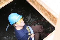 Laura in the crawl space (Bendini) Tags: alaska anchorage habitatforhumanity globalvillage