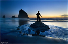 I. A CASTLE CONQUERED .I (donpar) Tags: ocean light sunset summer sky beach water colors silhouette rock oregon canon reflections island coast movement sand bravo rocks long exposure waves pacific northwest dusk tide fine shoreline wave shore shade haystack cannon sandcastle individual conquered donpar donparimages