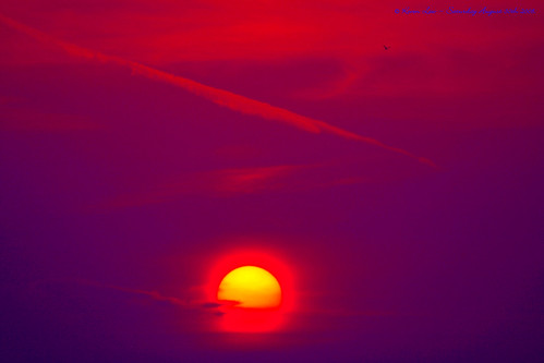 The red tones of the sky at sunset and sunrise are caused by Mie Scattering. The hues of blue, violet, and green in the sky are caused Rayleigh Scattering.