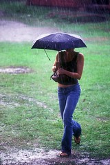 Soaked in a summer storm  Rob Watkins 2006 (Aland Rob) Tags: summer woman storm cute wet girl rain umbrella finland walking slim walk top sandals clothes jeans soak land tall splash heavy raining brolly soaked aland aaland finstrom