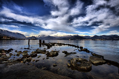 Ideal Pier (! .  Angela Lobefaro . !) Tags: trip travel blue schnee winter vacation sky italy panorama lake snow mountains alps tree bird nature water leaves clouds landscape lago island xt see pier flying interestingness bravo rocks europe italia quality patterns wideangle bleu explore piemonte ciel cielo nubes neve neige isolabella chateau nuages schloss alpi idyllic eos350d lombardia piedmont castillo chateaux allrightsreserved italians lagomaggiore isola lombardy lakemaggiore stresa verbania vco prealps sigma1020 i500 cesvi natuzzi isoleborromee borromeanislands mywinners holidaysvacanzeurlaub angelalobefaro angelamlobefaro wwwcesviorg massimilianogreco