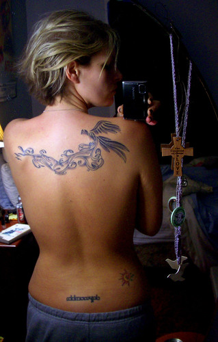 Tattoo on the back of a bird