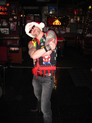 Brian Grosz as Tattooed Santa Pimp. At his Ugly Holiday Sweater Jamboree.