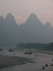 Karst landscape (Sparky the Neon Cat) Tags: china sunset mountain river landscape li countryside boat scenery asia ship chinese limestone karst guangxi xingping