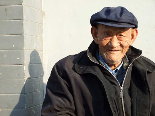 A friendly 85 year-old, sitting outside his home in one of the hutongs near Yonghegong