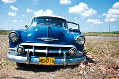Blue Taxi (lynn.h.armstrong) Tags: door camera old blue vacation sky brown white ontario canada green art field grass leaves car yellow coral clouds lens geotagged photography bay photo interesting mac aperture nikon long flickr jeep zoom taxi south cuba may plate ground headlights grill safari lynn h license nikkor varadero armstrong stormont vr afs gettyimages dx sault ingleside 2011 ifed 18200mm ple f3556 attributionnoderivs vrii d7000 ccbynd lynnharmstrong requesttolicence