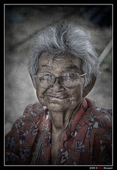 Grand Ma #2 (Thailand) (Eric Rousset) Tags: voyage old travel grandma portrait people woman texture face lady photoshop thailand photography reflex bravo asia searchthebest cs2 bangkok sony femme thalande adobe asie 2008 dragan visage postprocessing blueribbonwinner artisticexpression outstandingshots passionphotography alpha100 mywinners sonydslra100 worldbest anawesomeshot bratanesque excellentphotographerawards brillianteyejewel betterthangood piproduction ericrousset ericroussetphotography