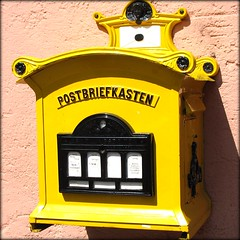 Nostalgic Letterbox (Batikart) Tags: old travel vacation yellow mailbox germany square geotagged deutschland holidays europa europe alt urlaub historic gelb postbox nostalgic letterbox cochem vacanze nostalgie briefkasten rheinlandpfalz historisch nostalgisch 10faves postbriefkasten viewonblack batikart m1896gelb