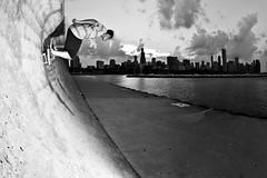 cruisin' (Jesus Arellanes) Tags: bw white chicago black alex silhouette skyline downtown skateboarding fisheye soto alexsoto jarellanes