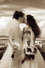 The Kiss (0olong) Tags: city wedding girls sky monochrome sepia kissing edinburgh marriage brides holyroodpark saintanthonyschapel 0olong
