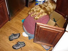 You know you are officially a couple when your girlfriend comes over to help you move into a new apartment....  not to be nice or to help out, but to make sure you leave enough room on your shelves for her stuff! (colorblindPICASO) Tags: kitchen sarah floor longhair ground jeans barefoot barefeet boxes sweatshirt whitesocks hardwoodfloor tupperware kitchenstuff cleaningup ontop wavyhair stiefel blondhair smallfeet hairdown hikingboots laarzen noshoes myoldapartment cabinetdrawer chromeappliances unpackingboxes maroonsweatshirt notwearingshoes biosdoi22d