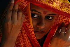 What Lies Beneath... (cmac66) Tags: red woman india eyes hands hand veil delhi ring orrange artcafe mywinners theunforgettablepictures earthasia globalworldawards artofimages bestportraitaoi artcafedomidoexhibitionscomein