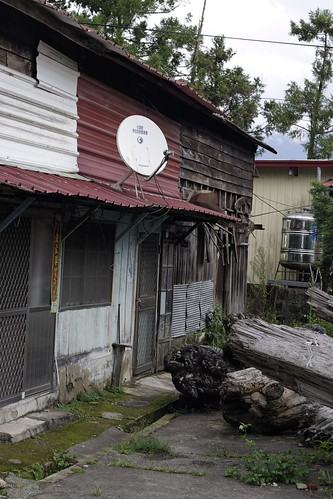 A row of old, but patched up houses. Satellite dishes are particularly common up in the mountains, since no other source of television signal is very practical.