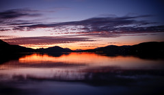 Twilight Reflection (mgratzer) Tags: sunset sea lake mountains color reflection water reflecting see colorful wasser sonnenuntergang sundown berge reflect bluehour dmmerung sundrop spiegelung afterglow abendrot aftersunset blauestunde twilights spiegeln karawanken showonmysite
