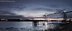 Northern lights (~Glen B~) Tags: bridge autostitch water clouds reflections river lights wooden dock long exposure dusk platform middlesbrough derelict transporter tees portclarence