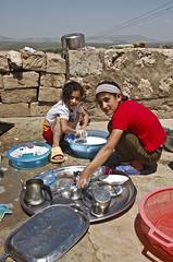Helping mother (Izla Kaya Bardavid) Tags: girls people color rooftop girl kids rural turkey children photo village child working dishes washing mesopotamia turabdin assyrian syriac southeastturkey