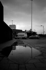 006 (Blacknoise) Tags: road street sky urban reflection film home water car 35mm puddle photography diy leeds streetphotography delta olympus xa2 400 push analogue van xa process developed hc ilford pushprocess ilforddelta ilfotec