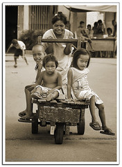 Pasyal (manfrommanila) Tags: poverty cemetery kids canon children wheels poor young mother powershot push cart ina inay s3is kariton flickristasindios manfrommanila dakila junbalasbas indioscemetery061408 northcemetry