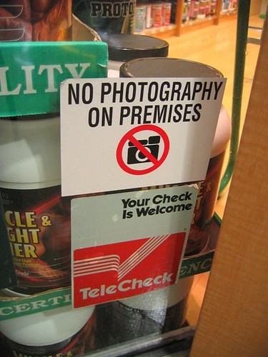 No photography on premises sign