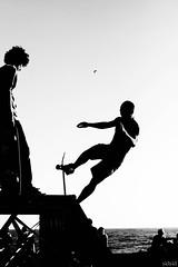 [skater boy] (NaNa [supergirl]) Tags: boy bw white black love silhouette sport festival canon eos monocromo jump rotonda bn e skate skater salto movimento 2008 livorno bianco nero controluce ragazzo rampa azione leghorn ardenza blackwhitephotos 400d italiawave
