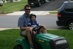 Kade mowing with John