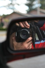 a reflection (oliverwales.) Tags: street portrait color reflection car canon myself lens mirror 18 intothelens