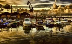 Atardecer en el puerto (Fernando Rey) Tags: sea sky clouds port boats puerto atardecer mar barcos cielo nubes noon soe hdr cantabria astillero elastillero