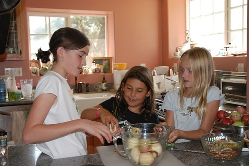 The girls coring & peeling apples