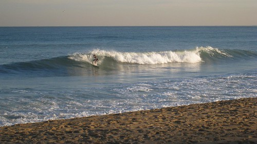 Surfers braved the cold waters with full wetsuits