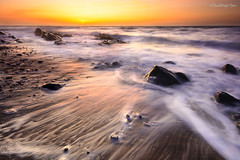 White and Gold! (Suddhajit) Tags: longexposure sunset spring waves hitech isleofman goldenlight kirkmichael sigma1020 supershot glenmooar canoneos400d platinumphoto gnd09 vosplusbellesphotos suddhajit
