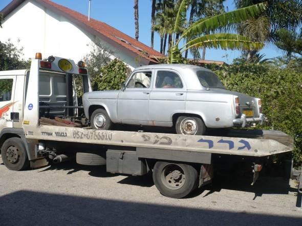 Departing 1960 Ford Prefect: Up on the tow truck side view