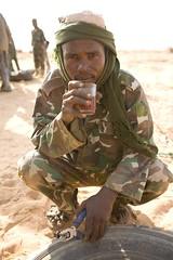 Meet The Janjaweed-21.jpg (Andrew Carter) Tags: fighter tea sudan headscarf arab conflict militia darfur tyre pliers janjaweed unreportedworld