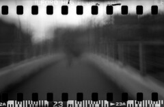 010 (Blacknoise) Tags: street camera bridge people urban bw white abstract black blur film home 35mm lens toy person photography diy long exposure pin hole toycamera leeds streetphotography holes pinhole plastic diana pedestrians hp5 analogue developed hc ilford sprocket plasticlens sprocketholes ilfotec