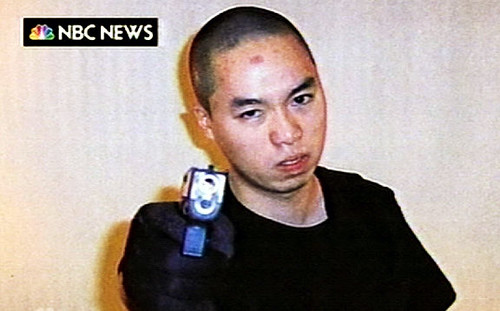 Image of Cho Seung-Hui pointing a handgun at the camera before the Virgina Tech Shootings